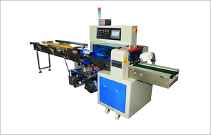 Glove packaging machine